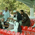 Handing out match scorecards, Imams vs Christian Clerics cricket match, Leicestershire Country Cricket Ground, Grace Road, Leicester, 11 September 2006